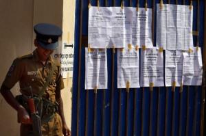 Security at a Colombo polling station.EPA/M.A. Pushpa Kumara