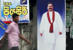 Walk on by: a campaign poster for Mahinda Rajapaksa. Reuters/Dinuka Liyanawatte